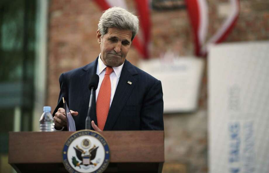 U.S. Secretary of State John Kerry pauses as he delivers a statement to the media on the Iran nuclear talks in Vienna, Austria, Thursday. Photo: Carlos Barria — Pool Photo Via AP   / POOL REUTERS