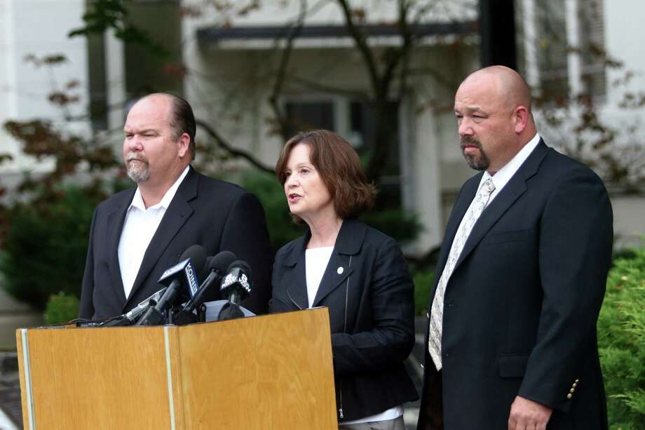 Douglas County Commissioners Tim Freeman, from left, Susan Morgan and Chris Boice hold a news conference in Roseburg, Ore., Wednesday. President Obama's calls for stricter gun laws in the wake of the shootings did not sit well with many people in this conservative region, where gun ownership is pervasive. Photo: The News-Review Via AP   / The News-Review