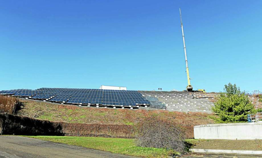 Solar panels being installed at the former dump on Universal Drive, as seen from the North Haven Water Pollution Control facility. Photo: Peter Hvizdak — New Haven Register   / ©2015 Peter Hvizdak