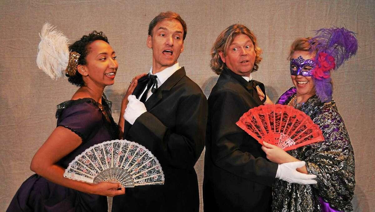 "Lisa Williamson (Adele), left, Mark Womack (Falke), Marc Deaton (Eisenstein) and Amanda Hall (Rosalinda) in Opera Theater's production of ""Die Fledermaus."""