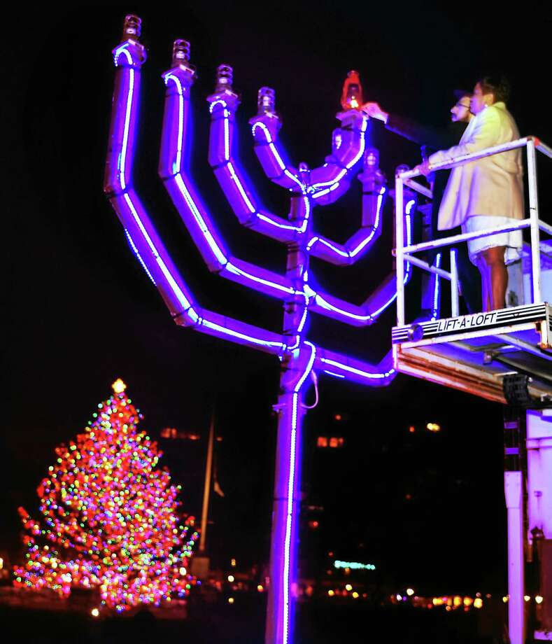 (Peter Hvizdak - New Haven Register)  Rabbi Gershon Borenstein of the Chabad Yeshiva of New Haven and New Haven Mayor Toni N. Harp prepare to light the Menorah Sunday evening on the New Haven Green celebrating the first night of Hanukkah. Photo: ©2015 Peter Hvizdak / ©2015 Peter Hvizdak