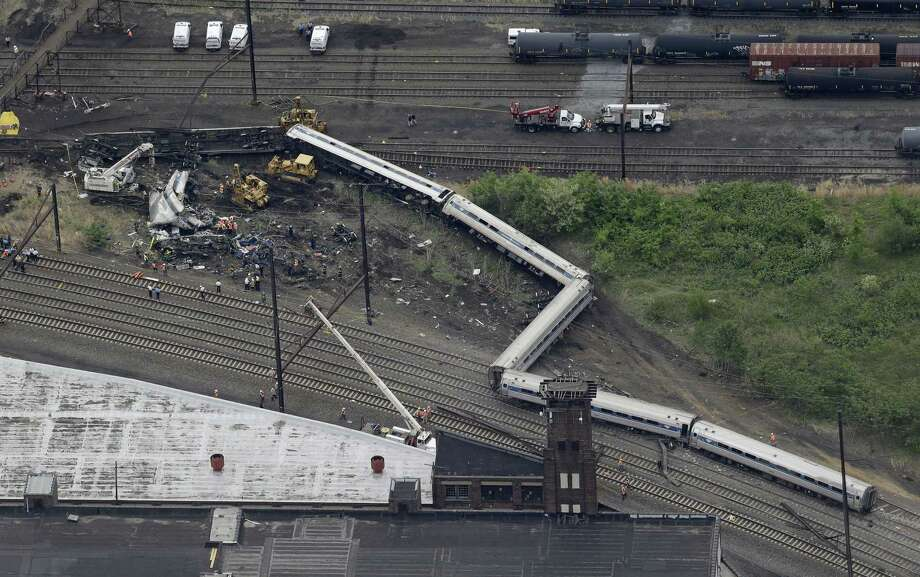 Emergency personnel work at the scene of a deadly train derailment May 13 in Philadelphia. Photo: Patrick Semansky — The Associated Press   / AP