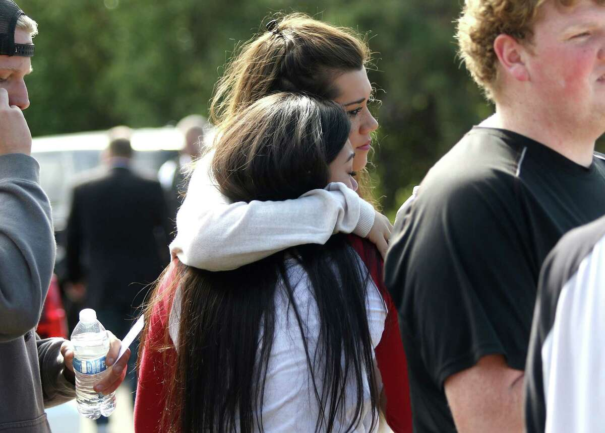 Umpqua Community College students react after a deadly shooting was reported on the campus in Roseburg, Ore., Oct. 1.