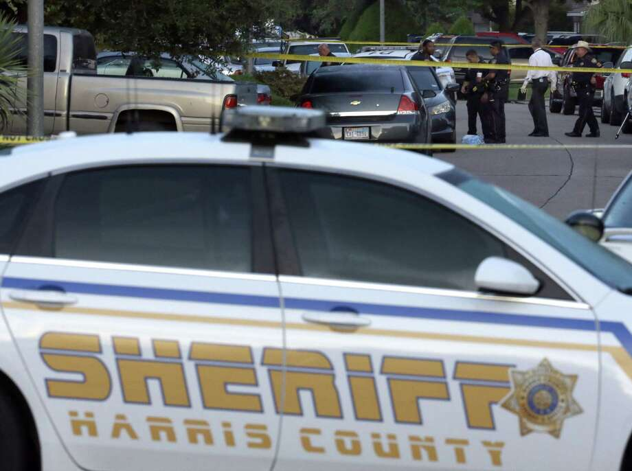 Members of the Harris County Sheriff's department work outside the scene of a shooting on Aug. 9, 2015 in Houston. At least eight people, including five children and three adults, were found dead late Saturday inside a Houston-area home following the arrest of a man who exchanged gunfire with police, Texas authorities said Sunday. Photo: AP Photo/David J. Phillip   / AP