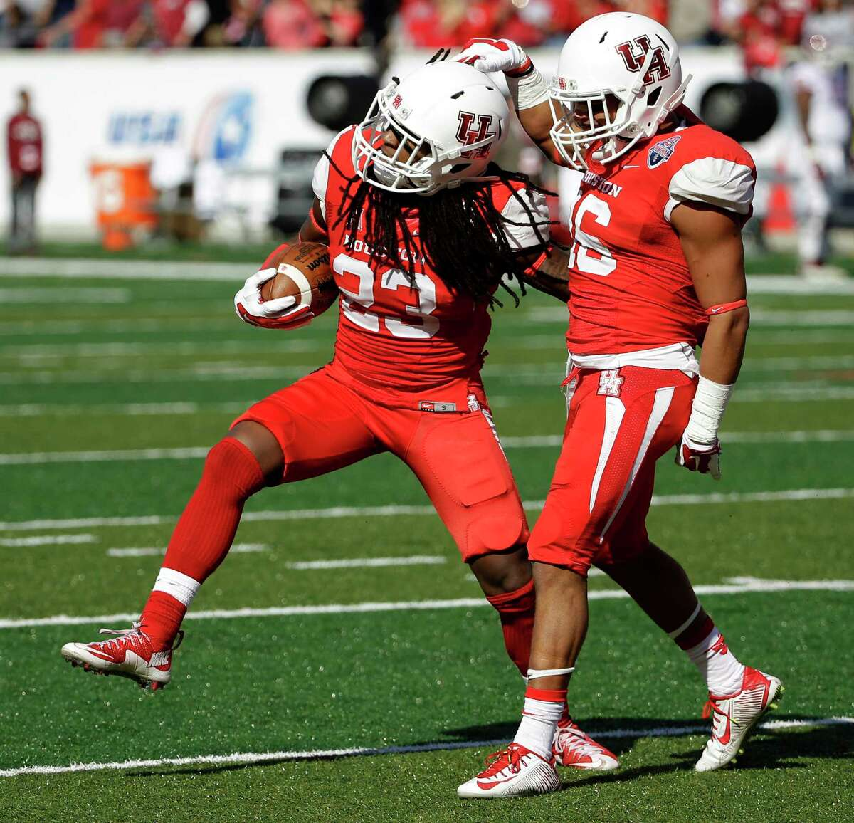 Houston safety Trevon Stewart (23) celebrates with safety Adrian McDonald after recovering a fumble on Saturday.