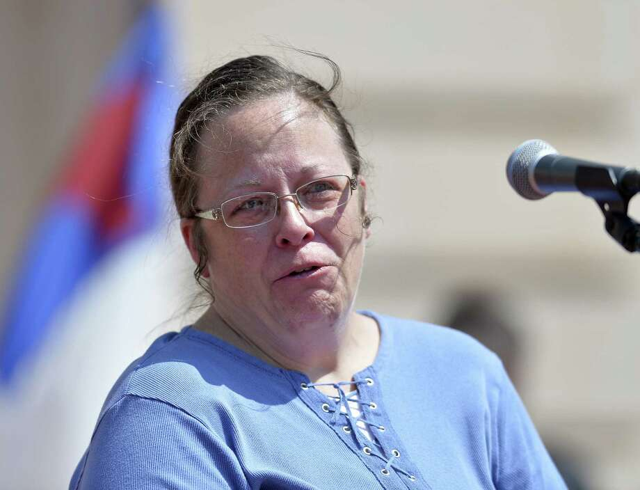 Rowan County Kentucky Clerk Kim Davis shows emotion as she is cheered by a gathering of supporters during a rally on the steps of the Kentucky State Capitol in Frankfort Ky. on Aug. 22, 2015. Davis spoke at the rally organized by The Family Foundation of Kentucky. Photo: AP Photo/Timothy D. Easley   / FR43398 AP