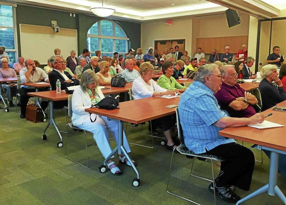 Attendees of the Branford Planning and Zoning Commission meeting Thursday await the decision on the Costco project. It was standing-room only shortly before the commencement of the meeting. Photo: Esteban L. Hernandez — New Haven Register