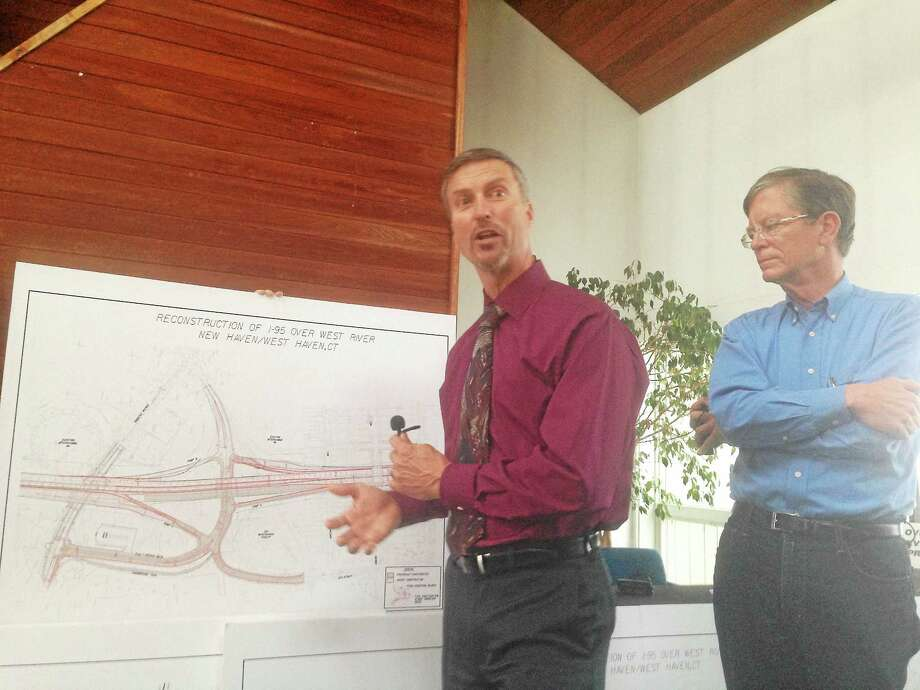 Department of Transportation Supervising Engineer Jim Pelletier, left, makes a point at a meeting of City Point residents. At right is Harbour Landing resident Jim O'Donnell. Photo: ED STANNARD — NEW HAVEN REGISTER