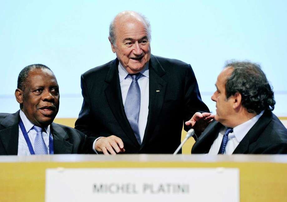 FIFA President Sepp Blatter, center, and UEFA President Michel Platini, right, have been banned for 90 days. Photo: The Associated Press File Photo   / MTI