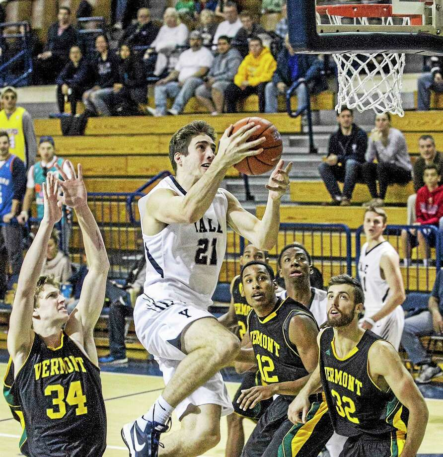 Yale's Nick Victor goes up for a layup during Saturday's game against Vermont. Photo: Photo By Steve Musco   / Steve Musco