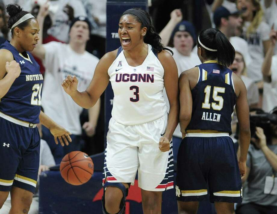 UConn's Morgan Tuck reacts after making a basket and being fouled during the first half Saturday against Notre Dame. Photo: Jessica Hill — The Associated Press   / FR125654 AP