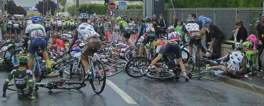 Riders crash during the fifth stage of the Tour de France on Wednesday. Photo: Sebastien Boue — The Associated Press   / L'Equipe