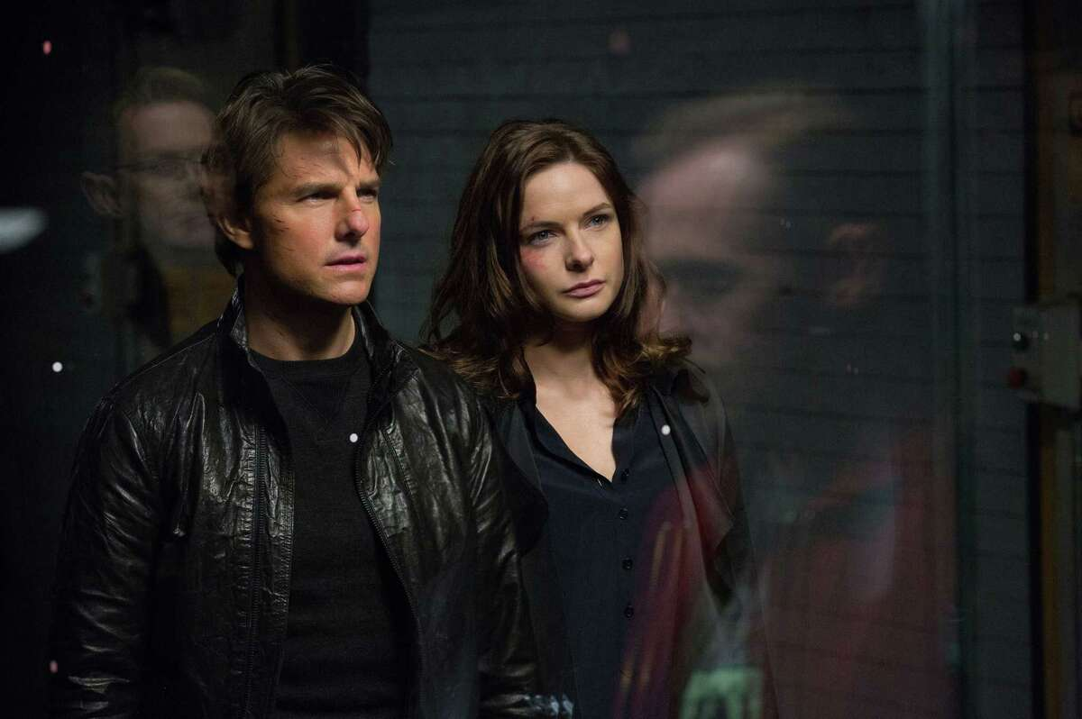 """In this image released by Paramount Pictures, Tom Cruise, left, and Rebecca Ferguson appears in a scene from """"Mission: Impossible - Rogue Nation."""""""