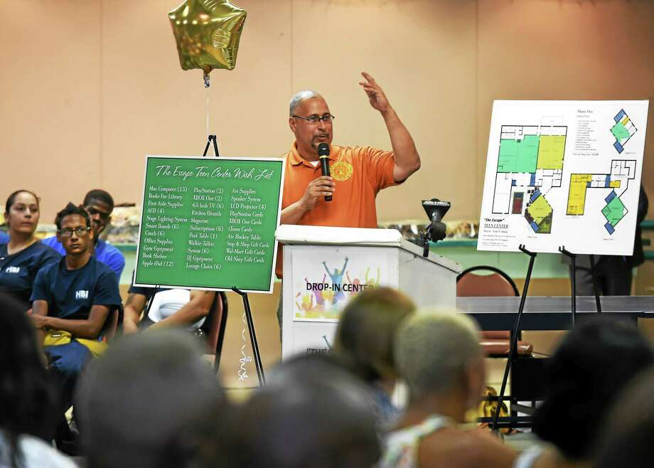 City Youth Services Director Jason Bartlett speaks at the future site of The Escape, the city's new teen center at 654 Orchard St., during a lease signing ceremony and reception Tuesday. Photo: Peter Hvizdak — New Haven Register   / ?2015 Peter Hvizdak