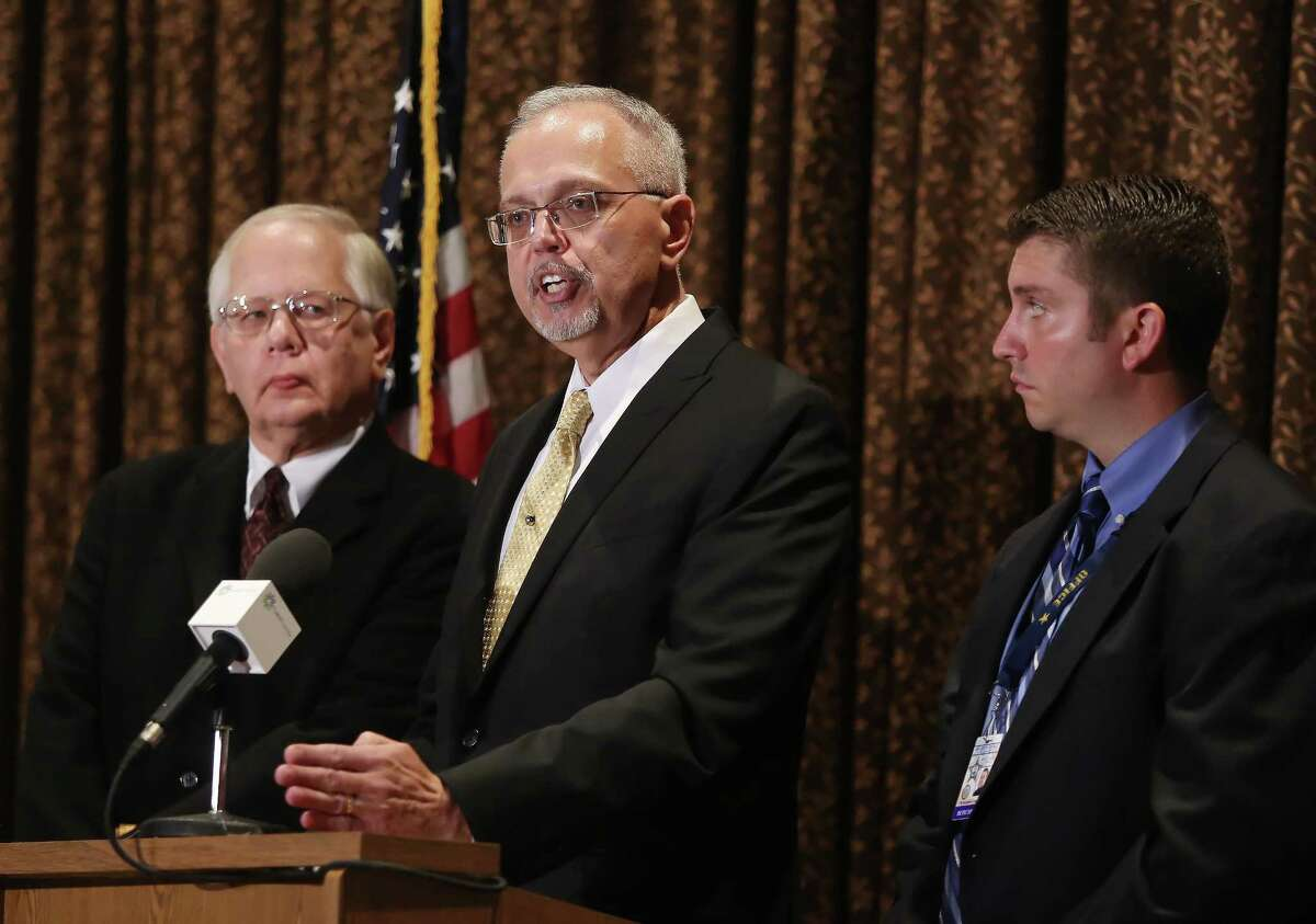Lake County Coroner Dr. Thomas Rudd, left, Lake County Major Crime Task Force Cmdr. George Filenko, center, and Lake County sheriff's Detective Chris Covelli confirm that Fox Lake Lt. Charles Joseph Gliniewicz, 52, died Sept. 1 of a self-inflicted gunshot wound, during a press conference Wednesday, Nov. 4, 2015, in Round Lake Beach, Ill. Gliniewicz carefully staged his death to make it look like he was killed in the line of duty. He had been stealing for years from a youth program he oversaw, authorities said Wednesday.