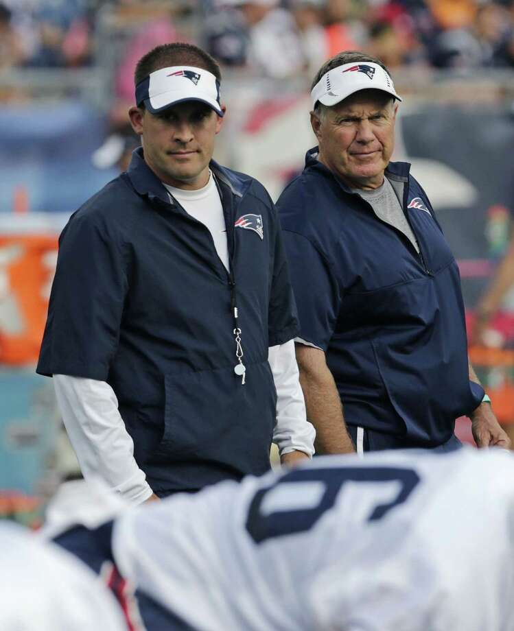 New England Patriots coach Bill Belichick, right, and offensive coordinator Josh McDaniels watch practice on Wednesday in Foxborough, Mass. Photo: Charles Krupa — The Associated Press   / AP