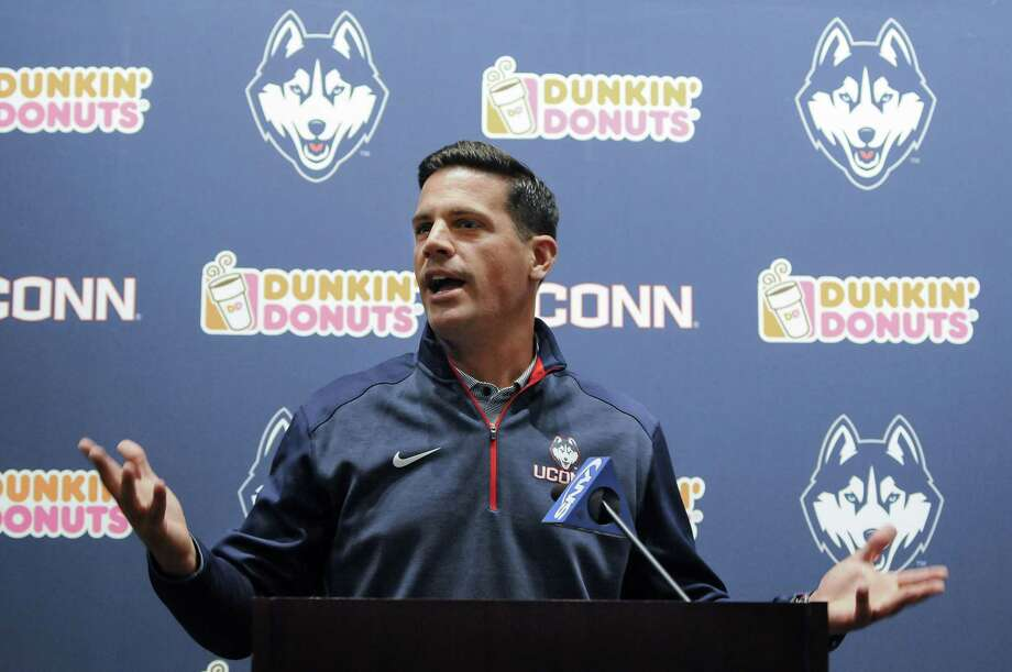 UConn football coach Bob Diaco speaks during a news conference Thursday in Storrs. Register sports columnist Chip Malafronte believes the manufactured Civil ConFLiCT between the Huskies and Central Florida will go a long way in either legitimizing UConn or spelling the end of the Diaco era. Photo: John Woike — The Hartford Courant   / The Courant