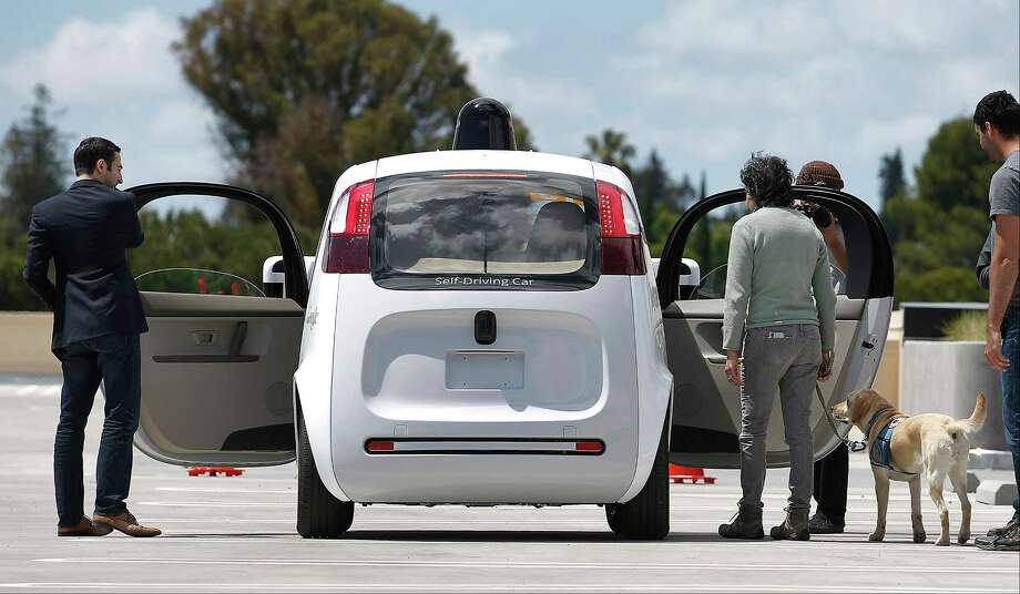 The rear of Google's new self-driving prototype car during a demonstration at the Google campus in Mountain View, Calif. New cars that can steer and brake themselves may lull drivers into a false sense of security. Photo: Tony Avelar — The Associated Press   / FR155217 AP