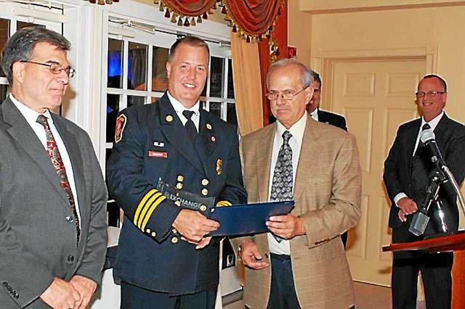 Branford Fire Deputy Chief Thomas Mahoney (center) is presented an award by Jack Mushin at the Connecticut's Bravest Award Ceremony in September 2014. Mahoney  has been appointed Fire Chief. Photo: Submitted Photo Courtesy Of Thomas Mahoney.