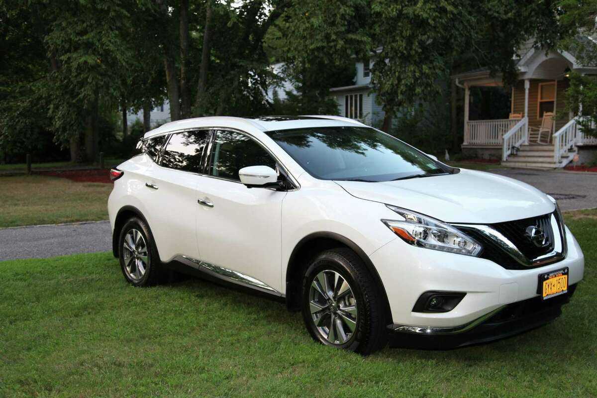 This Sept. 4, 2015 photo provided by Joseph Gerardi shows his 2015 Nissan Murano in Centereach, N.Y. Gerardi recently bought his car specifically for its semi-autonomous safety technology. As part of its $2,260 technology package, Nissan offers emergency braking and adaptive cruise control. The package also has forward collision warning, which uses radar to monitor both the car ahead of it and the car in front of that one.