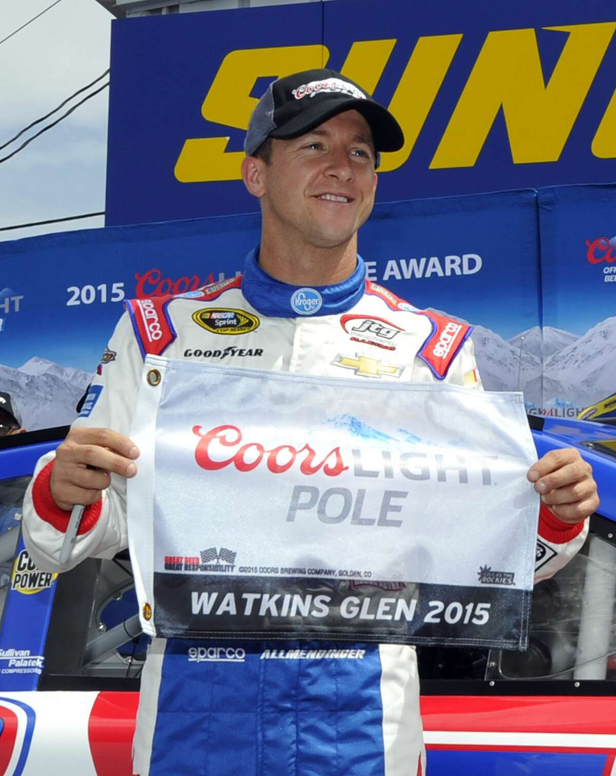 AJ Allmendinger poses with the pole award after qualifying Saturday for the NASCAR Sprint Cup race at Watkins Glen International in Watkins Glen. N.Y.