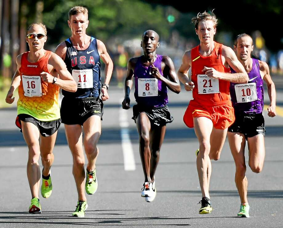 First-place finisher Jared Ward, far left, runs down the home stretch on Whitney Avenue battling, from left, Luke Puskedra (4th), Sam Chelanga (2nd), Tyler Pennel (5th) and Dathan Ritzenhein (3rd). Ward won the Faxon Law New Haven Road Race, and 20K national championship, on Monday. Photo: Peter Hvizdak — Register   / ©2015 Peter Hvizdak
