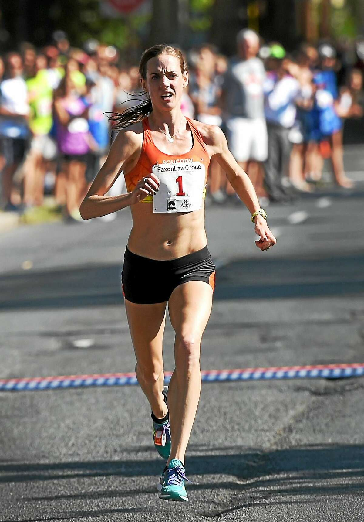 Molly Huddle runs toward the Temple Street finish line en route to winning the Faxon Law New Haven Road Race and 20K national championship on Monday.