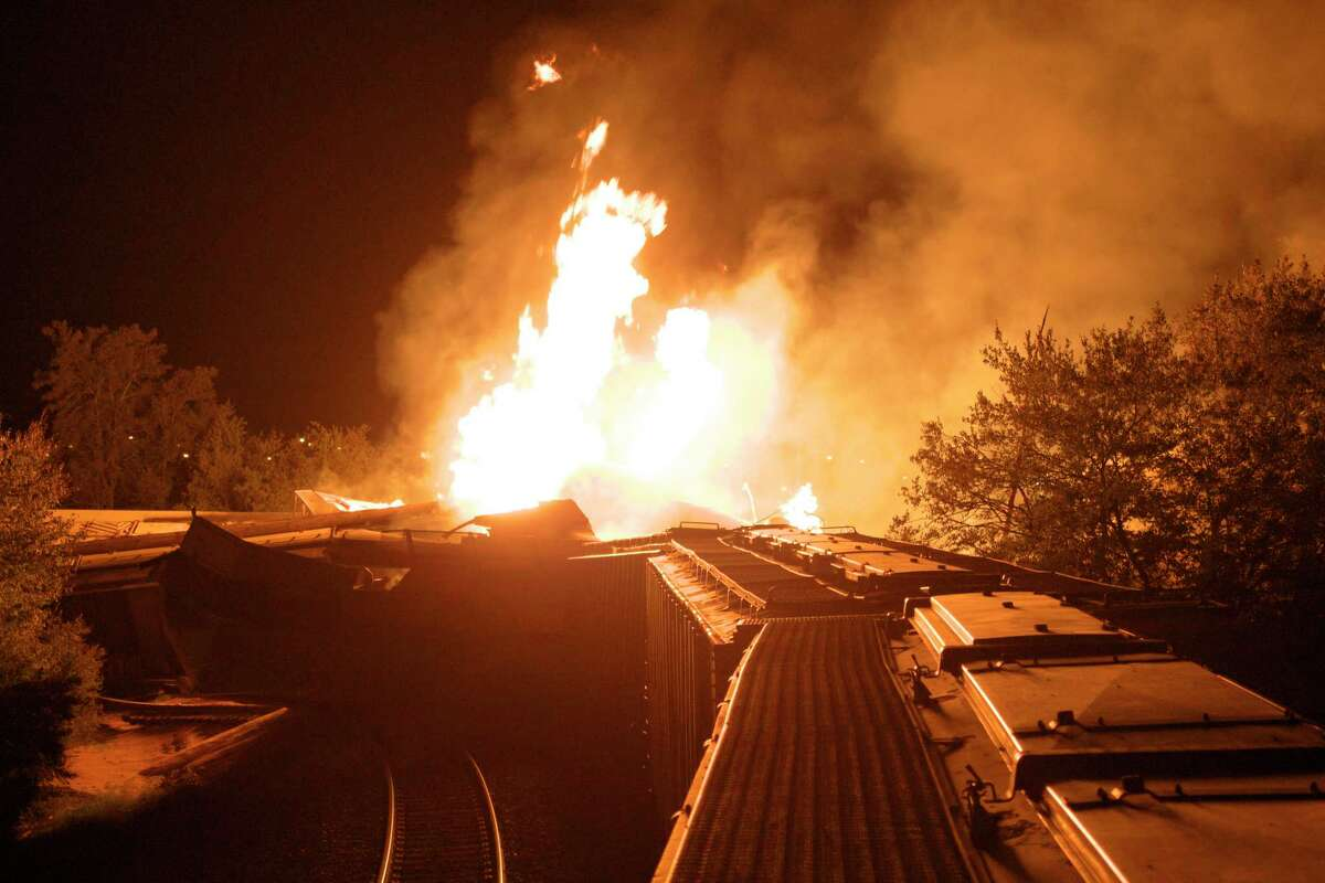 FILE - In this Wednesday, July 11, 2012, file photo, flames rise from a derailed freight train in Columbus, Ohio. A little-known truth about North American railroads: No rules govern when rail becomes too worn down. Since 2000, U.S. officials blamed rail wear as the direct cause of 111 derailments causing $11 million in damage.