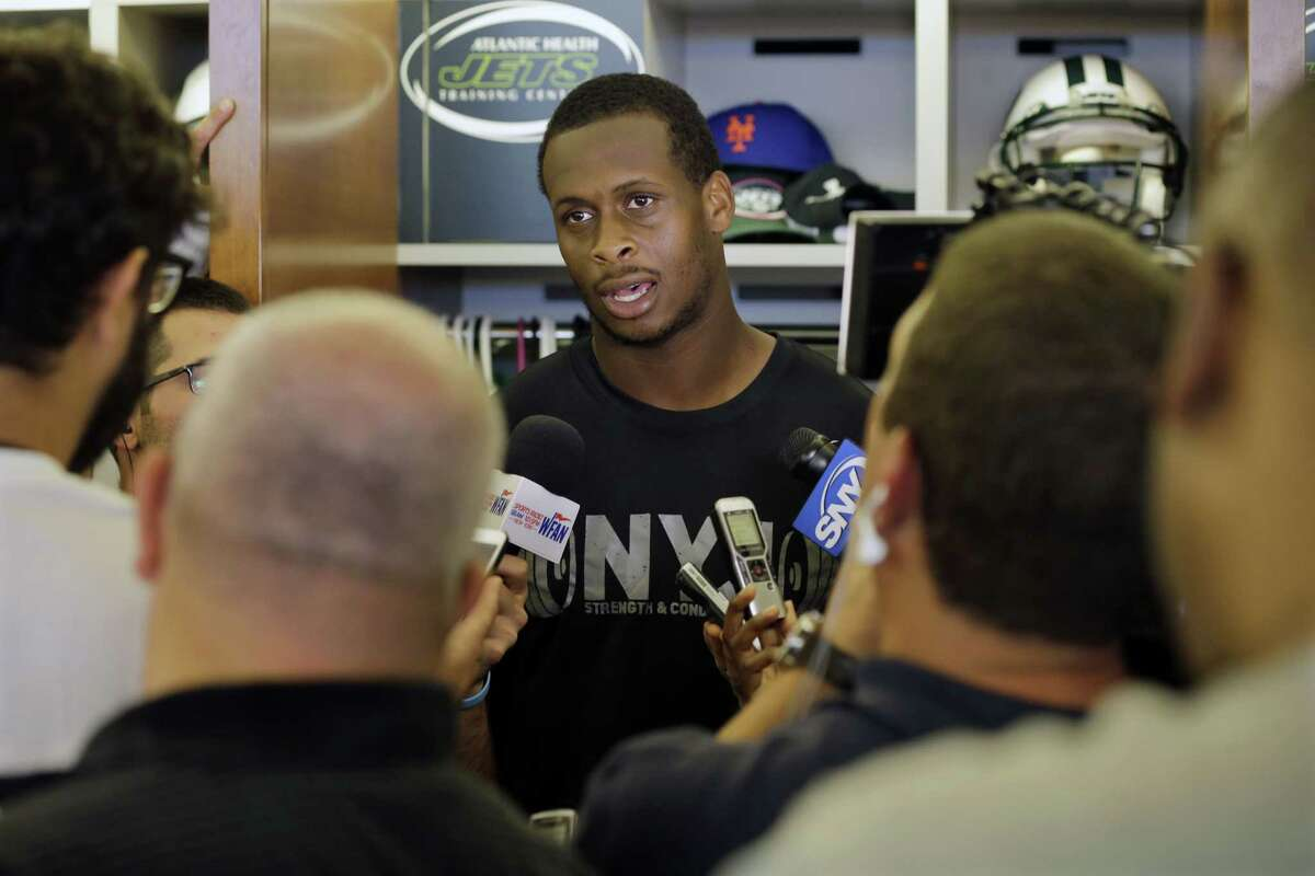 New York Jets quarterback Geno Smith answers a question in the locker room after practice Monday in Florham Park, N.J.