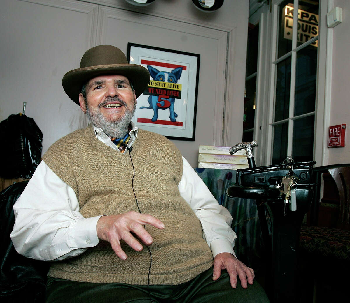 In this Friday, Feb. 2, 2007 file photo, chef Paul Prudhomme gestures during an interview at his French Quarter restaurant, K-Paul's Louisiana Kitchen, in New Orleans. Prudhomme, the Cajun who popularized spicy Louisiana cuisine and became one of the first American restaurant chefs to achieve worldwide fame, died Thursday, Oct. 7, 2015. He was 75.
