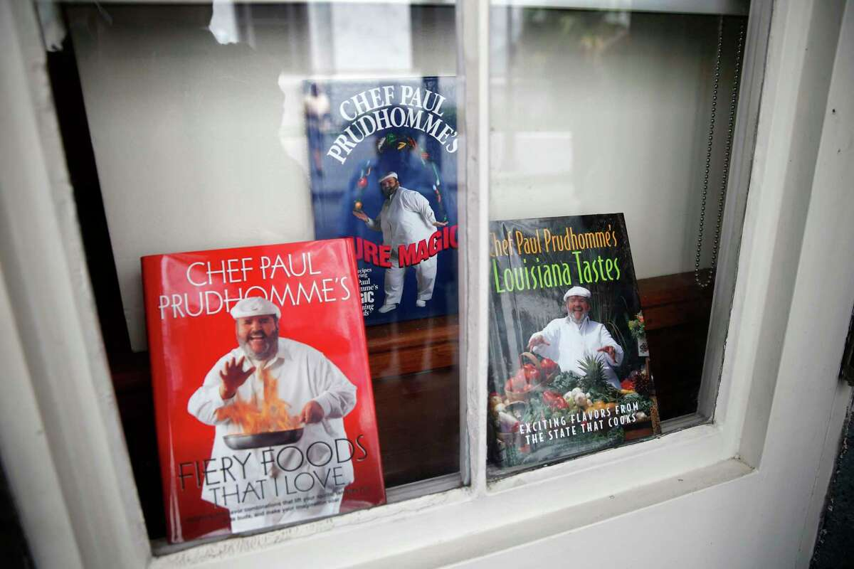Cookbooks by Chef Paul Prudhomme are displayed in a window at K-Paul's Louisiana Kitchen in the French Quarter of New Orleans, Thursday, Oct. 8, 2015. The proprietor, famed New Orleans Chef Paul Prudhomme, passed away Thursday. He was 75.