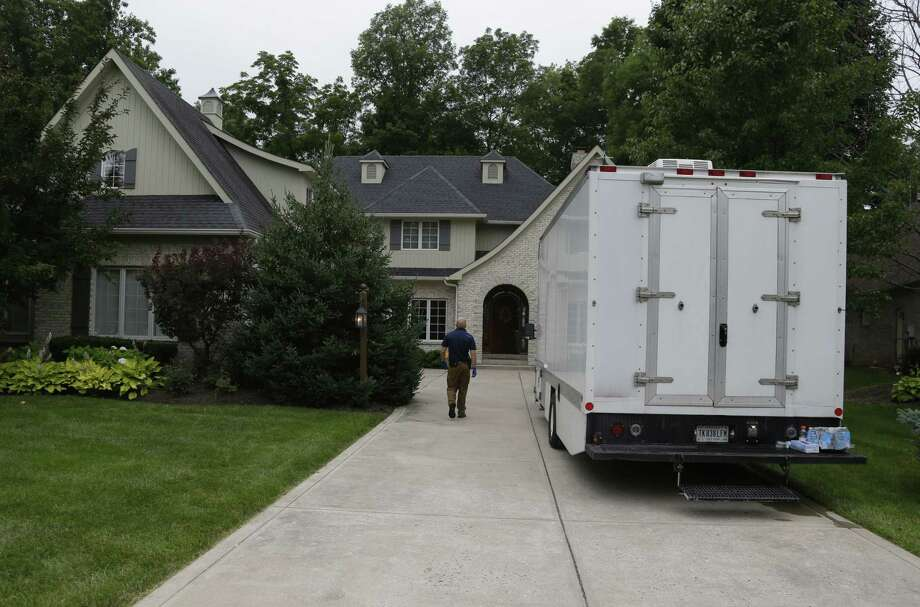 Federal authorities walk outside of the home of Subway restaurant spokesman Jared Fogle, Tuesday, July 7, 2015, in Zionsville, Ind. FBI agents and Indiana State Police have removed electronics from the property. Photo: AP Photo/Michael Conroy   / AP