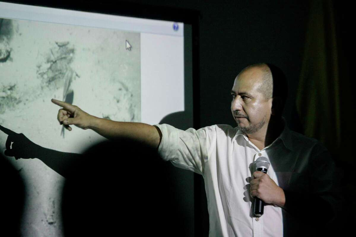 Ernesto Montenegro, Director of the Colombian Institute of Anthropology and History of Colombia, talks to the media while he shows a picture of remains of the Galleon San Jose during a press conference in Cartagena, Colombia, Saturday, Dec.5, 2015. Colombia's President Juan Manuel Santos announced the discovery of the remains of the Galleon San Jose, a Spanish boat eighteenth century empire that sank in the Caribbean Sea loaded with gold.