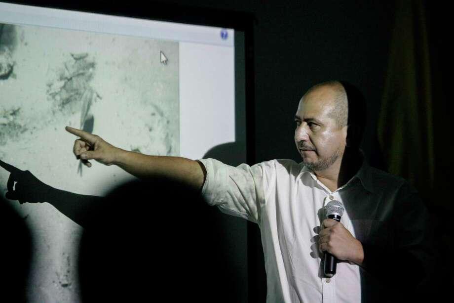 Ernesto Montenegro, Director of the Colombian Institute of Anthropology and History of Colombia, talks to the media while he shows a picture of remains of the Galleon San Jose during a press conference in Cartagena, Colombia, Saturday, Dec.5, 2015. Colombia's President Juan Manuel Santos announced the discovery of the remains of the Galleon San Jose, a Spanish boat eighteenth century empire that sank in the Caribbean Sea loaded with gold. Photo: AP Photo/ Pedro Mendoza / AP
