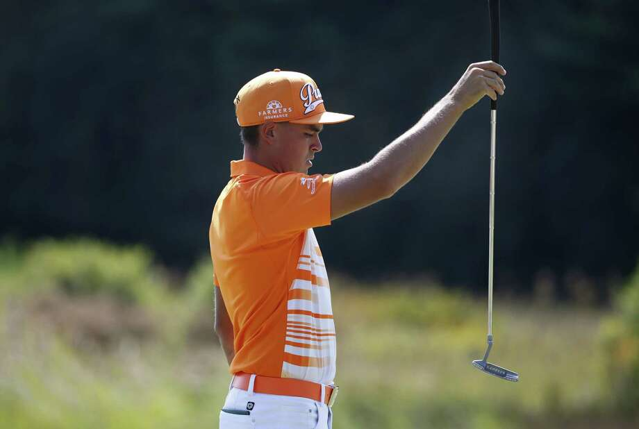 Rickie Fowler lines up a putt on the second hole during the final round of the Deutsche Bank Championship on Monday in Norton, Mass. Photo: Michael Dwyer — The Associated Press   / AP