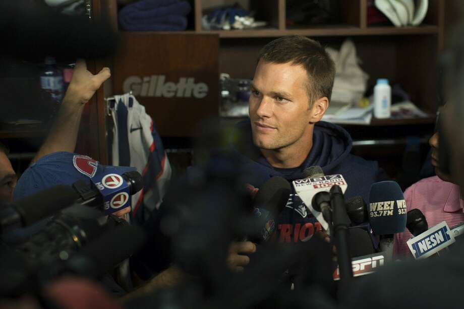 New England Patriots quarterback Tom Brady speaks to members of the media in the locker rook at Gillette Stadium prior to practice on Sunday in Foxborough, Mass. Photo: Keith Bedford — The Boston Globe   / 2015 - The Boston Globe