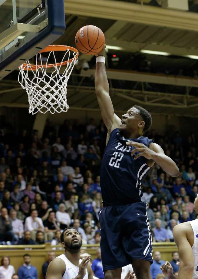 Yale's Justin Sears dunks against Duke during the second half of the Bulldogs' 80-61 loss on Nov. 25. Photo: Gerry Broome — The Associated Press   / AP