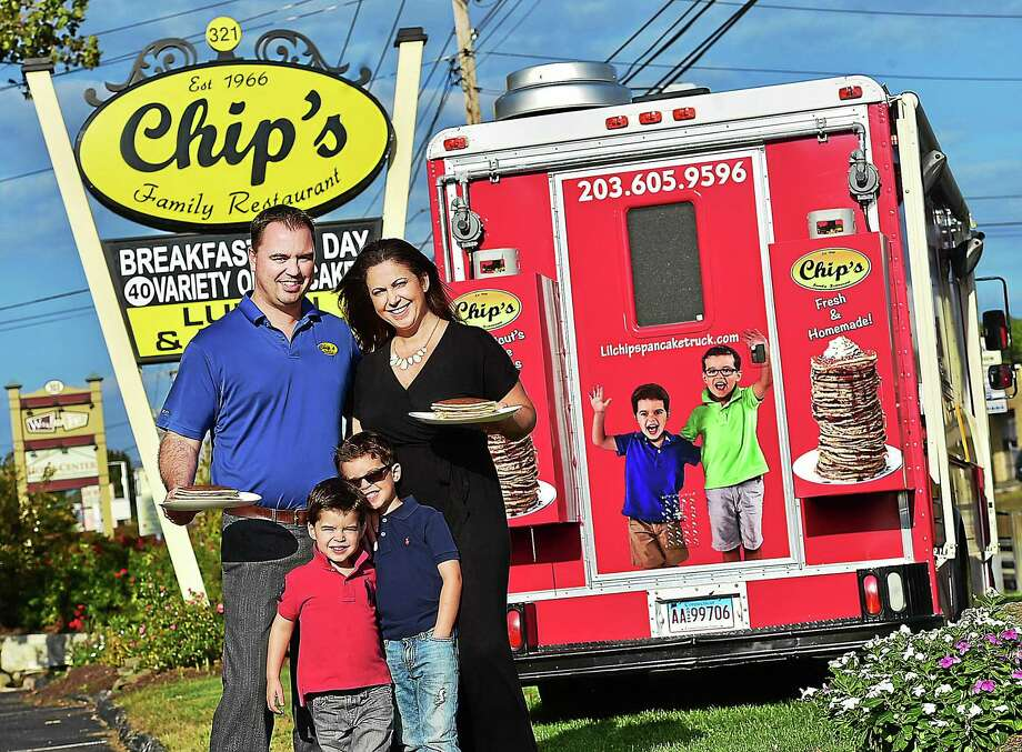 "Chip's Family Restaurant co-owner Dina Bajko, her husband, Adam Bajko, and their two sons, A.J., 5, and Alex, 3, are photographed with the restaurant's new food truck at 323 Boston Post Road in Orange. The Bajkos, along with Dina's brother and Chip's co-owner George Chatzopoulos, are venturing into the food truck arena. ""We are very excited and will be taking the food truck to private parties, festivals and corporate events,"" Dina Bajko said. Photo: Catherine Avalone — New Haven Register   / Catherine Avalone/New Haven Register"