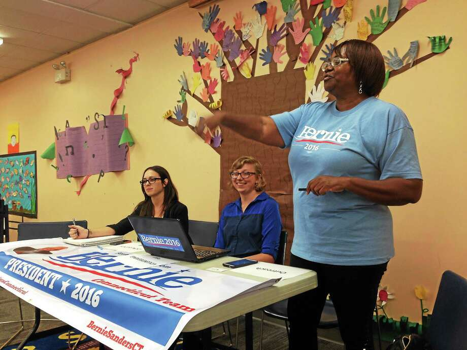 Leading a Bernie Sanders organizational meeting Thursday in New Haven are, from left, state events coordinator Kara Rochelle, volunteer coordinator Sarah Ganong and 3rd District coordinator Bonita Yarboro. Photo: Ed Stannard — New Haven Register