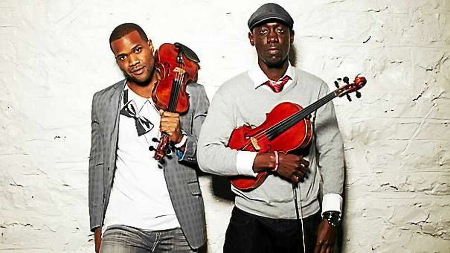 """Kevin """"Kev Marcus"""" Sylvester, left, and """"Wil B"""" Baptiste of Black Violin. Photo: Contributed"""