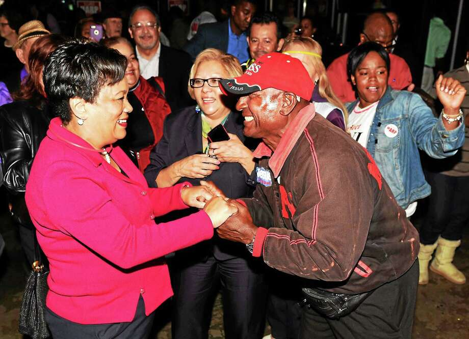 New Haven Mayor Toni Harp, with a supporter, as she celebrates her election day win and second term with a victory party at the Keys To the City piano bar on Long Wharf Drive in New Haven Tuesday, November 3, 2015. Photo: Peter Hvizdak -- New Haven Register   / ©2015 Peter Hvizdak