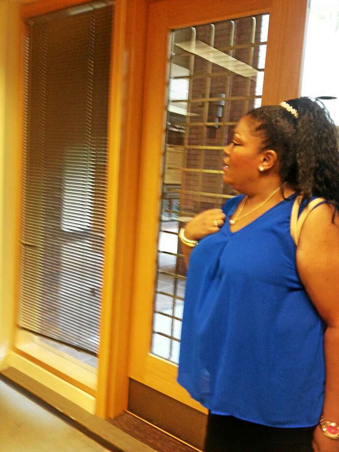 Nichole Jefferson enters CEO meeting July 30 that lacked a quorum. Photo: MARY O'LEARY — NEW HAVEN REGISTER