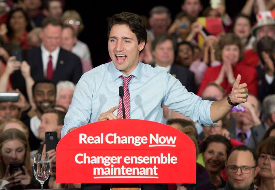 In this Oct. 20, 2015, file photo, Prime minister designate Justin Trudeau speaks to supporters at a rally in Ottawa, Ontario. Trudeau will be sworn in Wednesday, Nov. 4 as prime minister, the position long held by his late father, as Canada begins a new era of Liberal leadership after Conservative Stephen Harper's near-decade in power. Photo: Adrian Wyld/The Canadian Press Via AP, File    / The Canadian Press