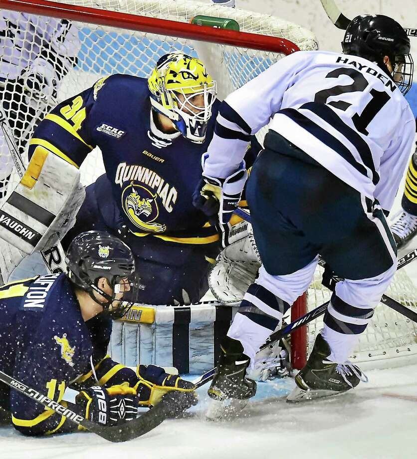 Quinnipiac goalie Michael Garteig picked up his school-record 60th career win on Friday night. Photo: Catherine Avalone — Register   / New Haven RegisterThe Middletown Press