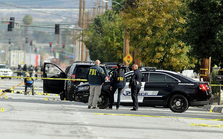 FBI, San Bernardino City and San Bernardino County Sheriff's officials continue documenting and investigating on Thursday, Dec. 3, 2015, the scene of the shootout between law enforcement officials and the mass shooting suspects which occurred on Wednesday. Photo: (James Quigg/The Victor Valley Daily Press Via AP)  / The Victor Valley Daily Press