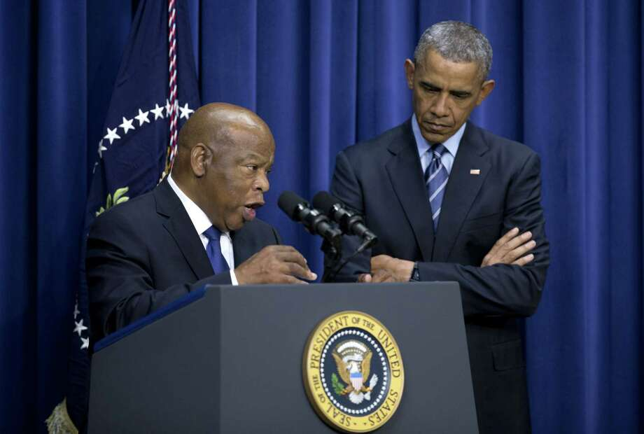 President Barack Obama stands by Rep. John Lewis, D-Ga., as he speaks in the South Court Auditorium in the Eisenhower Executive Office Building on the White House complex, Thursday, Aug. 6, 2015, in Washington, about the 50th anniversary of the Voting Rights Act. Photo: (AP Photo/Carolyn Kaster) / AP