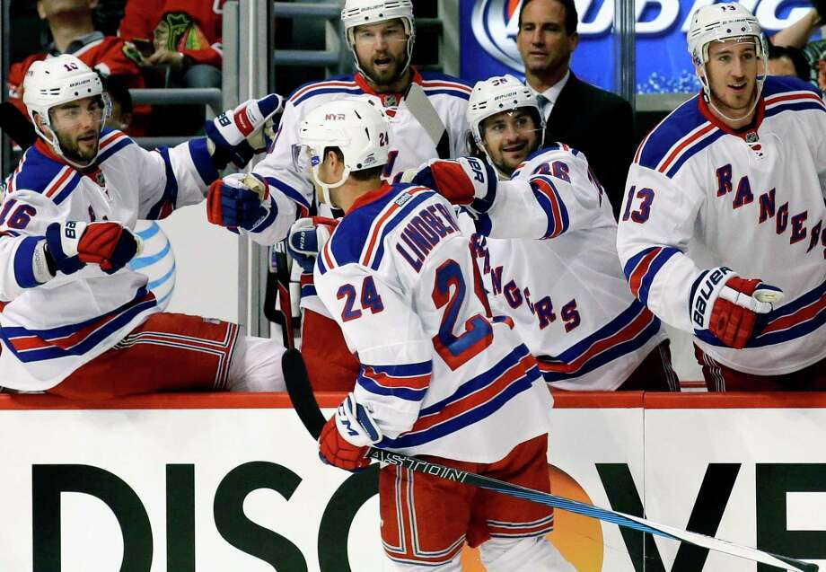 New York Rangers center Oscar Lindberg (24) celebrates with teammates after scoring against the Blackhawks during the first period Wednesday in Chicago. Photo: Nam Y. Huh — The Associated Press   / AP