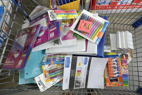 SCARBOROUGH, ME - AUGUST 20: Shopping cart full of school supplies as parents and their children shop for school supplies at Walmart in Scarborough. (Photo by John Patriquin/Portland Press Herald via Getty Images)