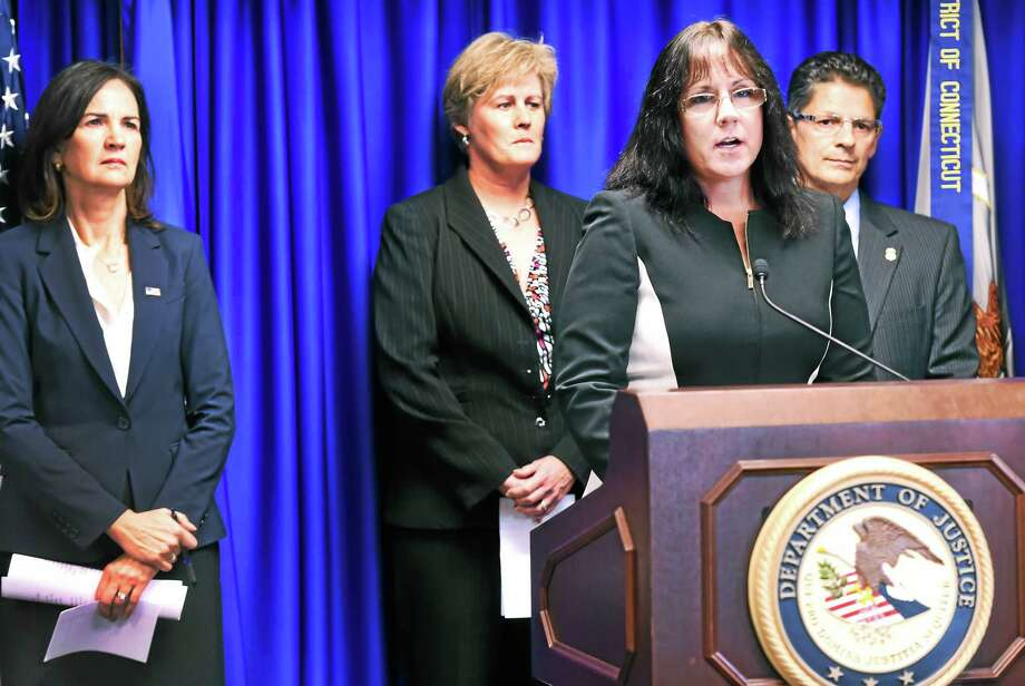 Tammy Sneed of the Connecticut Department of Children and Families speaks during a press conference Wednesday announcing the formation of the Connecticut Human Trafficking Task Force. At read, from left, are Connecticut U.S. Attorney U.S. Attorney Deirdre Daly; FBI Special Agent in Charge Patricia Ferrick; and Homeland Security Investigations Special Agent in Charge Matthew Etre. Photo: Peter Hvizdak — New Haven Register   / ©2015 Peter Hvizdak