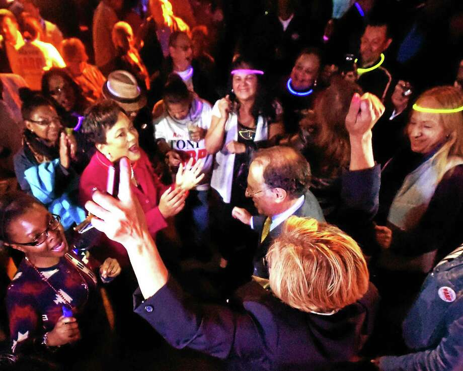 (Peter Hvizdak - New Haven Register)New Haven Mayor Toni Harp dances with her supporters as she celebrates her election day win and second term with a victory party at the Keys To the City piano bar on Long Wharf Drive in New Haven Tuesday, November 3, 2015. Photo: ©2015 Peter Hvizdak / ©2015 Peter Hvizdak